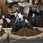 Coffee beans in the Souq, ready brewed in plastic bottles