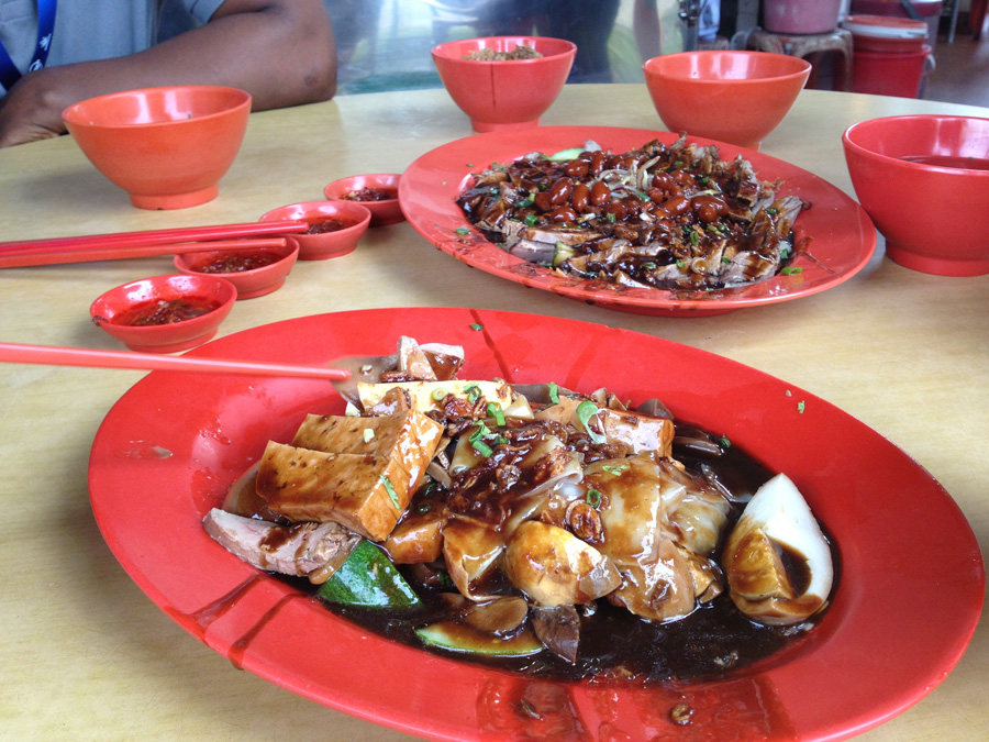 Teochew duck meal - offal, tofu and egg in foreground, braised duck centre piece, delicious rice and stock too